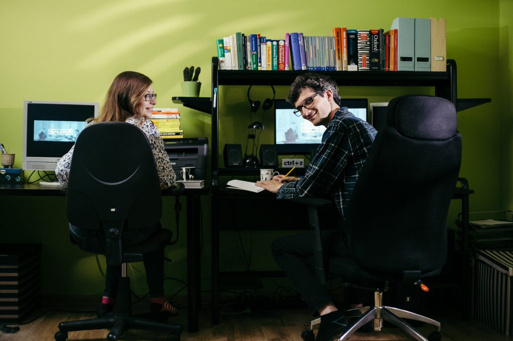 two translators in their home office